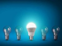 Idea concept on blue background. Row with light bulbs and LED bulb.